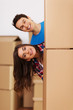 Couple having fun during moving in their home
