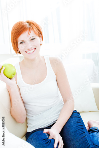 Beautiful girl with green apple