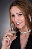Portrait Of Young Beautiful Woman Drinking Champagne