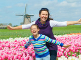 Boy with mother in the tulips field