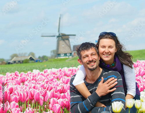 Young couple in the tulip field