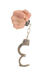 Close-up Hand Holding Handcuffs