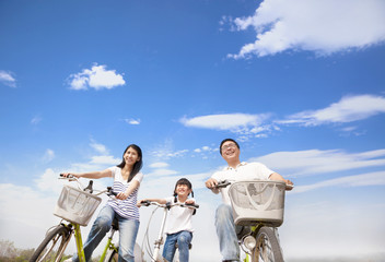happy family riding bicycle with cloud background