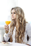 Beautiful woman in cafe restaurant in summer drinking juice