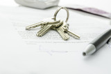 House keys on a contract of house sale