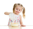 kid girl preparing corn flakes with milk