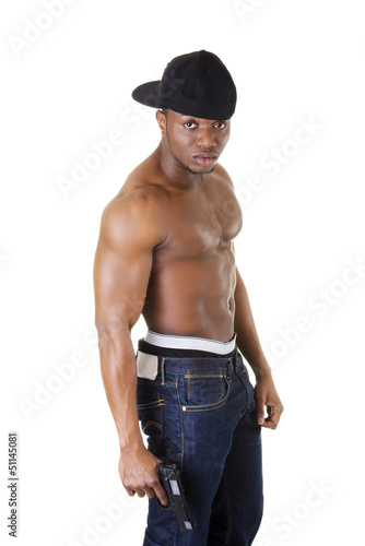 Afro american man standing with gun in hand.
