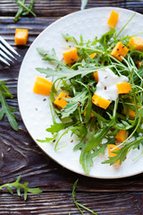 Light pumpkin salad with arugula and cream