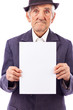 Elderly serious  man holding an empty white sheet of paper