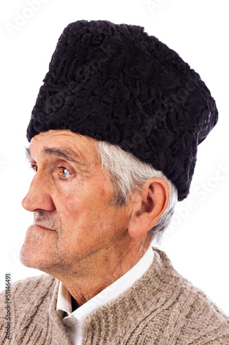 Portrait of a romanian old peasant with old fashion Astrakhan ha