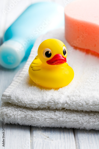 yellow bath duck on white towel