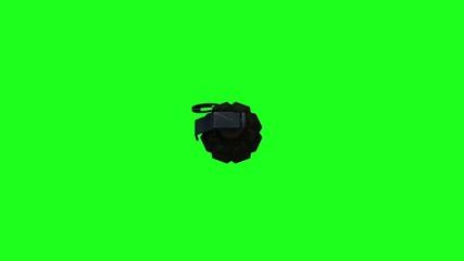 Granada de mano acercandose con fondo verde