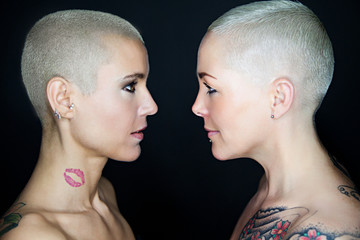 beautiful women with short hair looking eachother