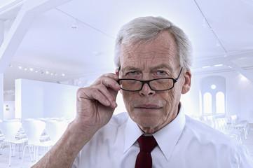 Senior man peering at the camera