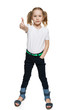 Little girl in full length making thumb up gesture