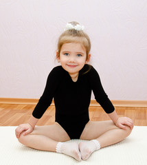 Gymnast cute little girl doing exercises