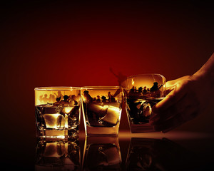 Three glasses of whiskey