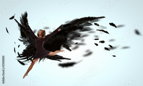 Woman floating   on dark wings
