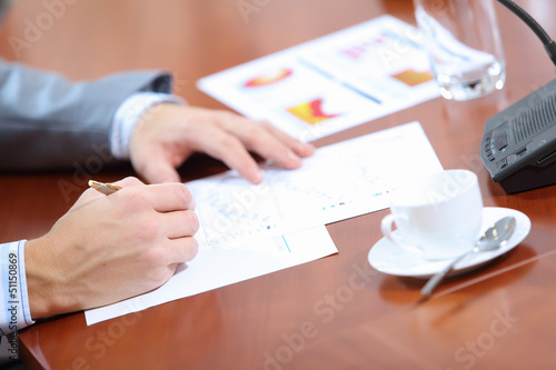 Hands of businessman writing