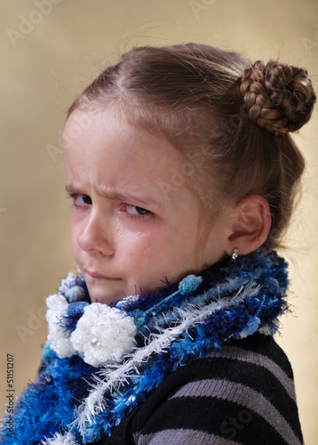 Sulking young girl with tears in her eyes