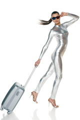Futuristic woman in silver clothing and 3D glasses with suitcase