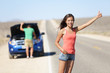 Car breakdown problems - woman hitchhiking
