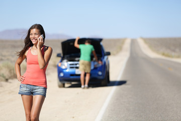 Car breakdown - woman phone calling auto service