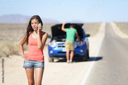 Car breakdown - woman calling auto service help