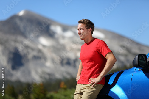 Car and driver man in beautiful mountain landscape