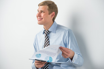 Portrait of confident business man holding document and thinking