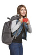 Woman tourist with backpack showing blank credit card