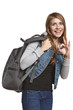 Excited girl hiker with backpack showing OK gesture