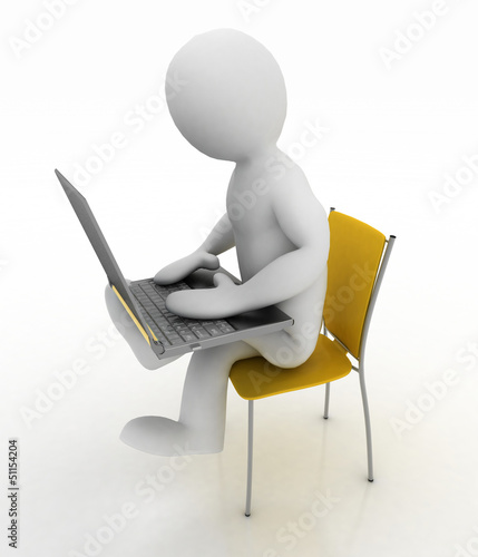 man sits on a chair with laptop