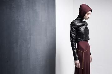 woman model posing very dramatic in an minimal studio setup