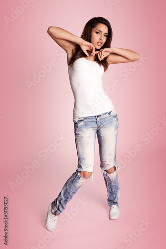 hip hop dancer posing standing sideways to the camera