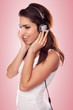 brunette woman listening brunette woman listening to the music