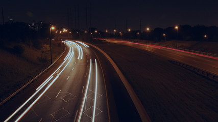 Highway corner. Timelapse at night. DVP in Toronto.