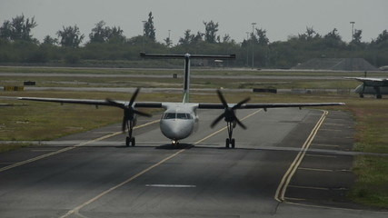 Turboprop airplane approaching