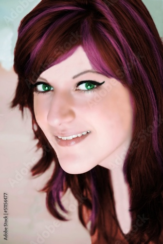young woman with brown red hair and green eyes