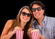 Happy couple watching a 3D movie