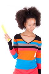 Black African American teenage girl combing her afro hair