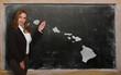 Teacher showing map of hawaii on blackboard