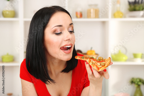 Beautiful girl wants to eat delicious pizza