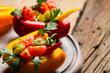 Closeup of vegetables salad in pepper bells