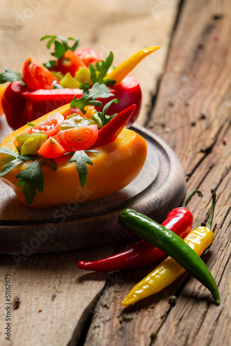 Salad made from fresh vegetables and served in bell pepper