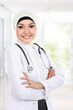 smiling asian medical doctor in scarf