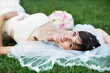 Happy bride on grass