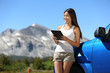 Traveler woman using tablet on Yosemite road trip