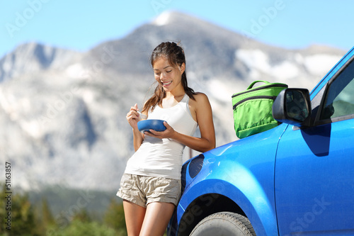 Car road trip woman eating in Yosemite Park