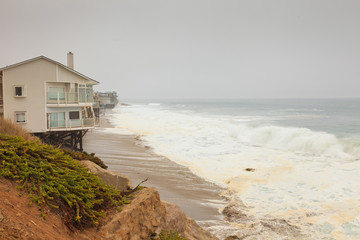 House on rocky coast of Malibu beach. USA. California.
